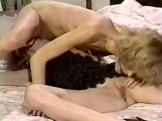 ribald retro twin sisters in a hot lesbo act